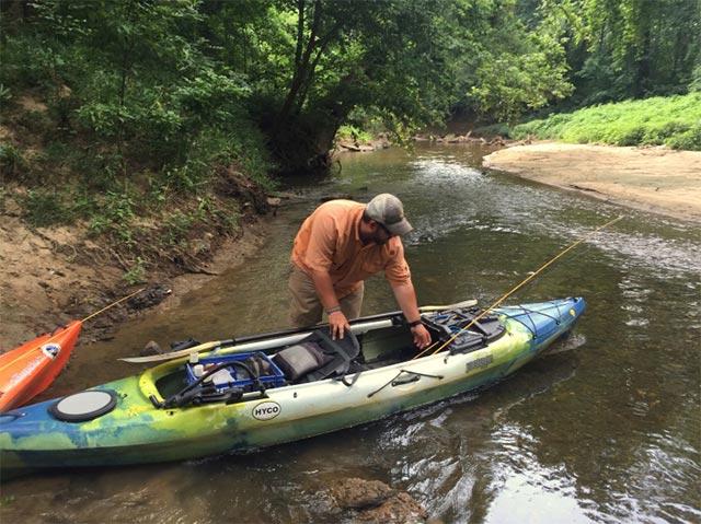 Kayaking and fishing on a creek